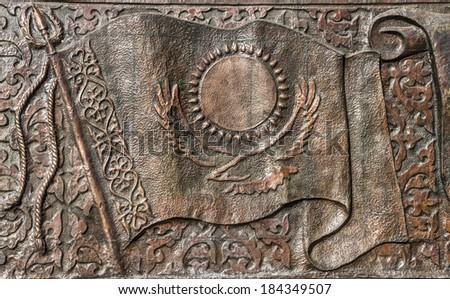 Kazakhstan flag engraved bronze - stock photo