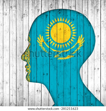 Kazakhstan flag of wood, human head and wood background  - stock photo