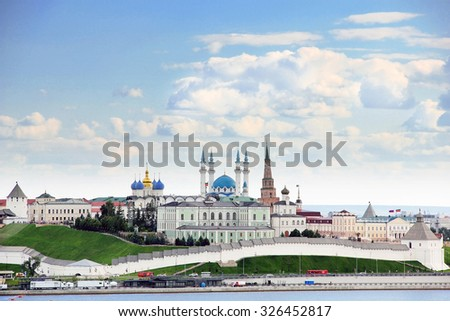 Kazan, Republic of Tatarstan, Russia. View of the Kazan Kremlin with: Presidential Palace, Soyembika Tower, Annunciation Cathedral, Qolsharif Mosque from the Kazanka River. - stock photo