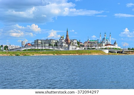 Kazan, Republic of Tatarstan, Russia. View of the Kazan Kremlin with Presidential Palace, Annunciation Cathedral, Soyembika Tower and Qolsharif Mosque from Kazanka River. - stock photo