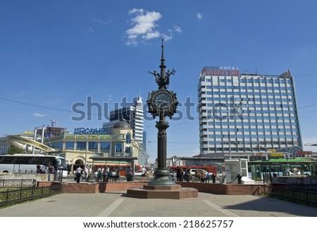 "KAZAN, RUSSIA - MAY 31, 2013: Bauman street - touristic centre of Kazan, capital of republic Tatarstan, decorative clock, hotels ""Tatarstan"" and ""Kazan"". - stock photo"