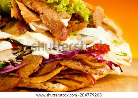 Kebab - grilled meat, bread and vegetables - stock photo