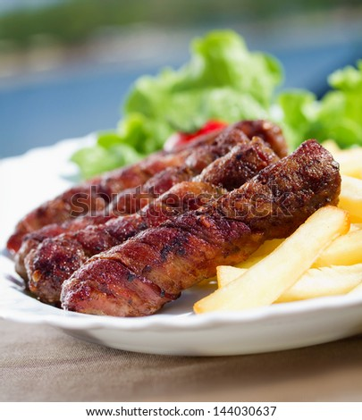 Kebab (kebap, kabab, kebob, kabob, kibob, kebhav, or kephav; also pinchos (puertorican), ��?evapi, or ��?evap���i��?i) is a wide variety of skewered meals originating in the Middle East - stock photo