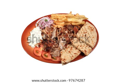 kebab served on plate  with pita fries and tzatziki sauce - stock photo