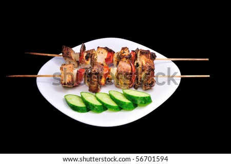 kebab with vegetables on black bacround - stock photo