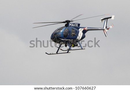 KECSKEMET, HUNGARY - AUGUST 7, a MD-500 police helicopter flies at the International Air and Military Show on August 7, 2010 in Kecskemet, Hungary - stock photo
