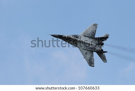 KECSKEMET, HUNGARY - AUGUST 7, a MIG-29 Fulcrum flies at the International Air and Military Show on August 7, 2010 in Kecskemet, Hungary - stock photo
