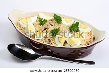 Kedgeree, flakes of smoked herring baked with rice, milk, stock, pepper and parsley, and served with hard-boiled eggs. A Scottish dish that was a particular favourite in British India. - stock photo