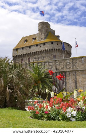 Keep behind the ramparts at Saint-Malo and flowers in the foreground. Saint-Malo is a walled port city in Brittany in northwestern France on the English Channel.  - stock photo