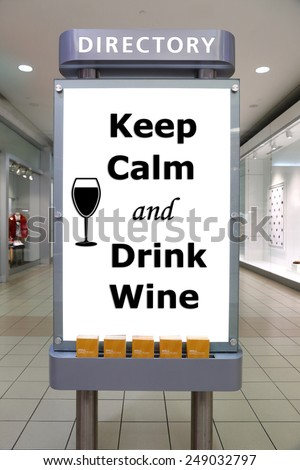 Keep calm and drink wine sign inside shopping mall - stock photo