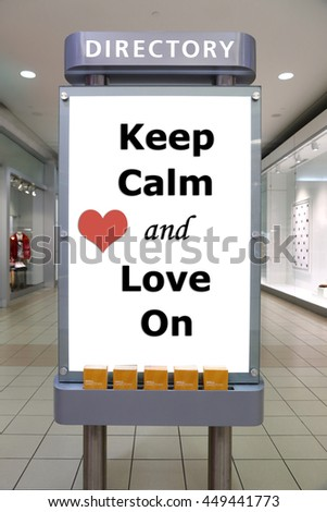 Keep calm and love on sign inside shopping mall - stock photo