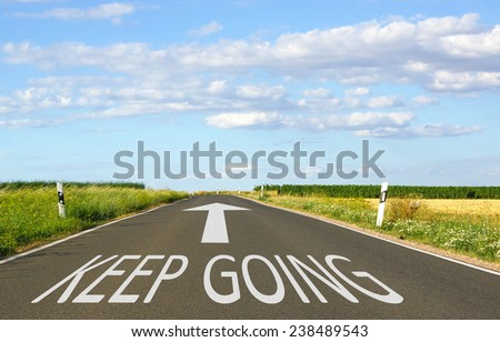 Keep Going - Business concept with street and arrow - stock photo