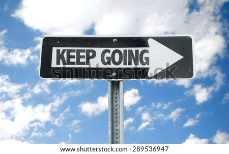 Keep Going direction sign with sky background - stock photo
