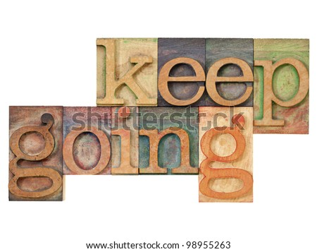 keep going - motivation  concept - isolated text in vintage letterpress wood type - stock photo