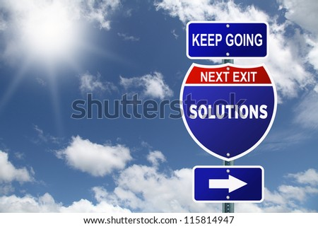 Keep going next exit solutions road sign - stock photo