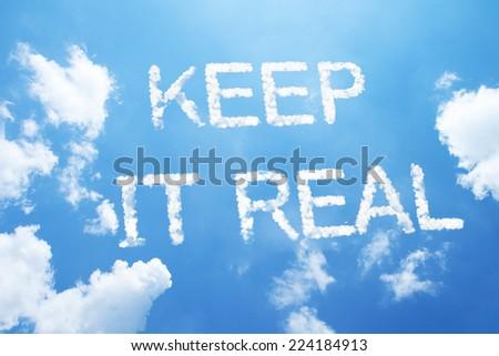 KEEP IT REAL cloud word on sky. - stock photo