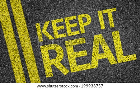 Keep it Real written on the road - stock photo