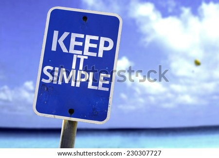 Keep It Simple sign with a beach on background - stock photo