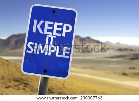 Keep It Simple sign with a desert background - stock photo