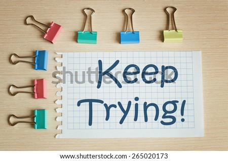 Keep trying! - stock photo