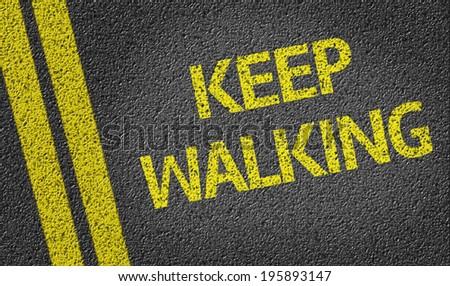 Keep Walking written on the road - stock photo
