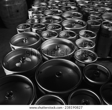 Kegs upon kegs at a brewery  - stock photo