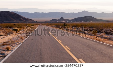 Kelbaker Road Approaches Needles Freeway US 40 California Desert - stock photo
