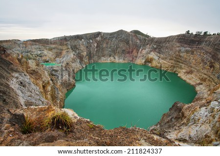 Kelimutu tricolor lakes Volcano. Flores, Indonesia - stock photo