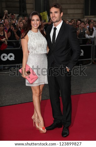 Kelly Brook and Thom Evans arriving for the 2012 GQ Men Of The Year Awards, Royal Opera House, London. 05/09/2012 Picture by: Alexandra Glen - stock photo