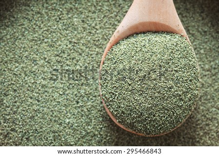 Kelp (algae) green powder healtly superfood - stock photo