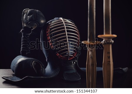 Kendo: men, kote and shinai, over dark background - stock photo