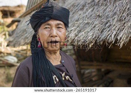 Kengtung, Myanmar - MAR 6: The unidentified old lady with black teeth in Eng Tribe Villager in Kengtung, Myanmar on March 6 2015. - stock photo