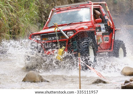 Keningau Sabah Malaysia - Nov 1, 2015:4x4 enthusiast wading a rocky river  using modified four wheel car in the jungle of Sabah Borneo.Jungle of Borneo is famous for 4x4 adventure tourism. - stock photo
