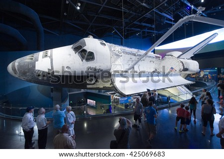 KENNEDY SPACE CENTER, FLORIDA, USA - APRIL 27, 2016: Visitors looking at Space Shuttle Atlantis which is exhibited at the visitor complex of Kennedy Space Center - stock photo