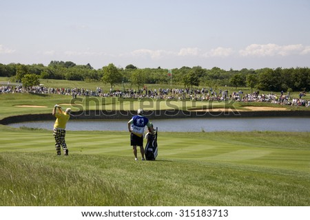 KENT ENGLAND, 29 MAY 2009. John DALY (USA) playing a shot from the fairway of the 5th hole during the second round of the European Tour European Open golf tournament.  - stock photo
