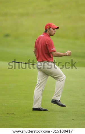 KENT ENGLAND, 27 MAY 2009. Pablo LARRAZ���§BAL (ESP) pumps his fist after hitting an eagle on the 13th hole playing in the first round of the European Tour European Open golf tournament.  - stock photo