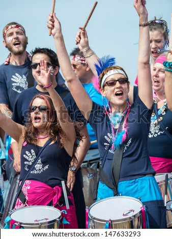 KENT, UK - JULY 27:  The Samba Pelo Mar band entertain the crowd during the landing of the oysters ceremony on the first day of the Whitstable Oyster Festival, in Whitstable July 27th 2013. - stock photo