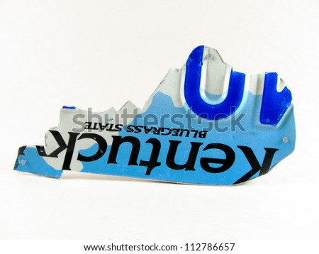 Kentucky license plate cut in shape of the state of Kentucky - stock photo