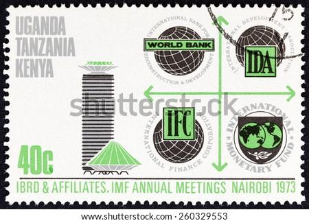 "KENYA UGANDA TANGANYIKA - CIRCA 1973: A stamp printed in Kenya Uganda Tanganyika from the ""I.M.F. / World Bank Conference "" issue shows Bank emblems and the Conference Centre, circa 1973.  - stock photo"