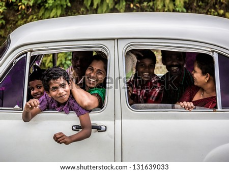 KERALA, INDIA - FEBRUARY 17: Happy unidentified family travels the country, Kerala February 17, 2013 in India. India is the world's second-most populous country. 1210193422 residents in the 2011 provisional census - stock photo