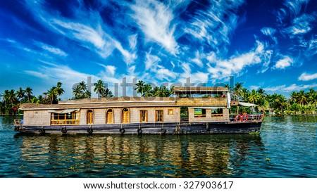 Kerala India  travel background - panorama of tourist houseboat on Kerala backwaters. Kerala, India - stock photo