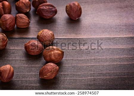 kernels of hazelnut on vintage wooden board horizontal version food and drink concept  - stock photo