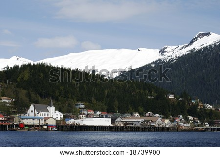 Ketchikan city skyline with snow-covered mountains in a background (Alaska). - stock photo
