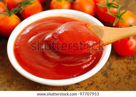 ketchup in wooden spoon - stock photo