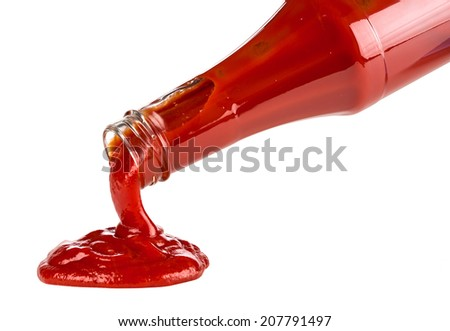 ketchup pouring out of bottle - stock photo