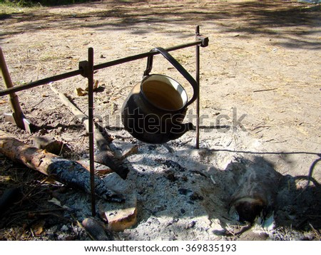 Kettle above the fireplace - stock photo