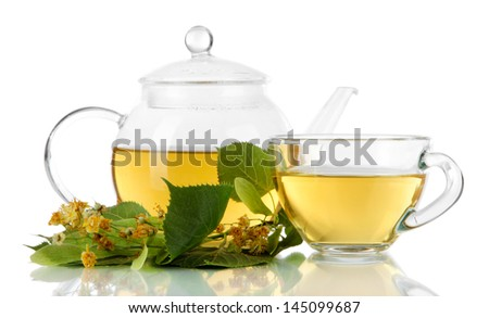 Kettle and cup of tea with linden isolated on white - stock photo