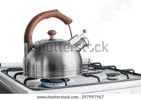 kettle boiling on a gas stove. Focus on a spout - stock photo