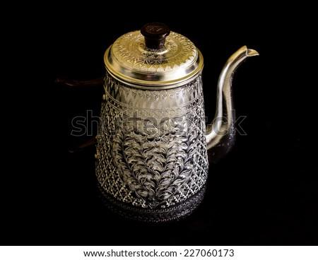 kettle on black background - stock photo