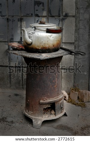 kettle on oven in chinese hutong streets - stock photo